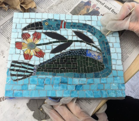 Debbie Whitney grouting her mosaic